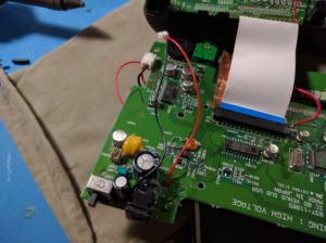A bit fuzzy on how i ended up wiring this. I believe ultimately I went with cutting the power traces at the DC port. Wiring the batteries to the DC port. Then also wiring the + terminal of the battery to + terminal on the original battery connector. That way the battery LED was still functional.